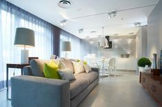etiles Showroom Lisbon, white round table, zebra rug, white chairs, grey sofa, geometric pillows