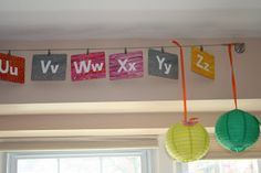 Alphabet hung by curtain wire and small clips (Eric Carle ABC cards)