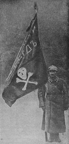 "White Russian solider bearing the flag of the White Russian ""Death Battalion"" [312x648]"