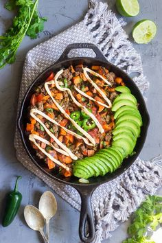 This taco sweet potato skillet is loaded with spicy taco meat, avocado, jalapeño, and chipotle ranch sauce. Dairy-free, paleo, Whole30 compliant.