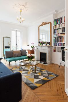 Parisian living room with mid-century modern rug and furniture via havenin. this geometric rug is perfect! Parisian Room, Parisian Decor, Parisian Style, Parisian Apartment, Apartment Living, Living Room Area Rugs, Living Room Furniture, Living Room Decor, Blue Velvet Accent Chair