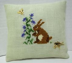 Garden Bunny Cross Stitched Mini Pillow by luvinstitchin4u on Etsy, $12.99