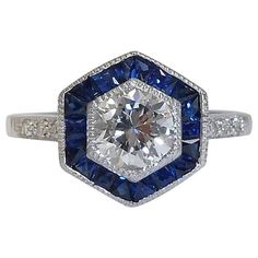 Art Deco 1.69 Carats Diamonds Sapphire Engagement Ring in Platinum | From a unique collection of vintage engagement rings at https://www.1stdibs.com/jewelry/rings/engagement-rings/