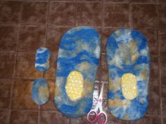 Wet felting slippers around moulds.