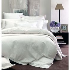 Monaco is from the Boutique Collection by Linen House.  It is a classic white embroidered duvet cover with embroidered flowers on the corners and an embroidered oxford edge.