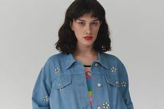 """Lazy Oaf Daisy Denim Jacket. Oversized mens-style jacket. Centre-front tack button opening. Custom Lazy Oaf buttons. Side seam pockets. Mock chest pocket flap details. All-over custom daisy embroidery. Warm machine wash. 100% Cotton denim. Available in sizes S/M-M/L. Izzy is 5'8"""", dress size 8 and wears a S/M."""