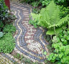 "As long as you don't have a thing about snakes (or ""those things without legs"" as a phobic friend of mine calls them), then how about this as a great garden path?Although it is a mosaic, I think it is more like an indigenous dot painting. on The Owner-Builder Network http://theownerbuildernetwork.co/wp-content/blogs.dir/1/files/mosaic/Mosaic-10.jpg"