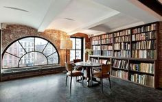 exposed brick, city view, amazing window, and a library....way too much awesome in this room.