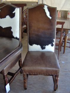 IN LOOOOOVE WITH THESE CHAIRS! cowhide, dining chair, nailhead cowhide