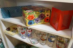 Groovy vintage tin with bright flower designs.