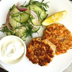 That lemony yogurt dipping sauce though. Get the Recipe: Salmon Cakes with Lemon-Yogurt Sauce and Cucumber Dill Salad   - Delish.com