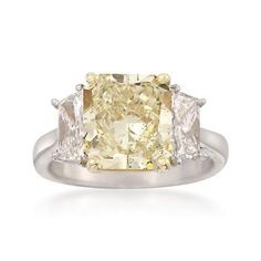 4.53 Carat Fancy Yellow Diamond Ring With 1.40 ct. t.w. Side Diamonds in Platinum and 18kt Yellow Gold