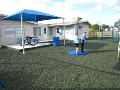 Backyard Playground With Green Rubber Mulch Surface