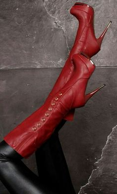 """""""Red Boots"""" ...  """"These Boots were Made For Walking"""" .. """"And That's Just What They'll Do"""" .. """"Please Don't Let These Boots"""" ..  """"WALK ALL OVER YOU"""" ..."""