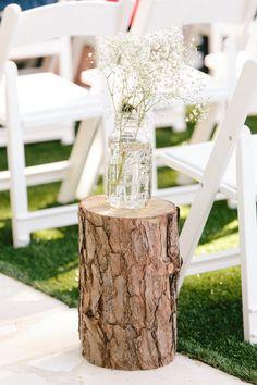 rustic baby's breath tree stump wedding aisle  / http://www.himisspuff.com/rustic-babys-breath-wedding-ideas/7/