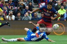 Barcelona's Uruguayan forward Luis Suarez vies with Espanyol's defender Victor Alvarez during the Spanish league football match FC Barcelona vs RCD...