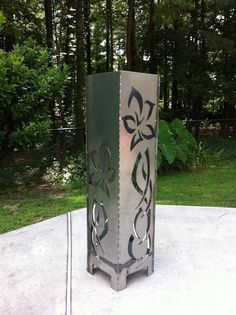 *The Flower fire-pit stands 40 tall and is 10 wide on all four sides. *Features a beautiful lotus flower etched and cut to create an exotic backdrop to your outdoor setting.  *This sculptural fire pit can function as a gorgeous element either hot or cold.  * Place in your garden with landscape solar lighting to have continued beauty year round! *These modern fire pits will enhance your outdoor space -- great for parties, barbeques, family gatherings, and more!  *Functional artwork for your…