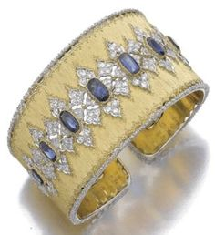 What makes Buccellatti so special is the way gold is worked, a unique way to resemble cloth and lace.  A satin finished bangle set with diamonds and sapphires in an intricate lace design.