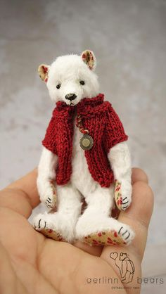 Miniature bear Pippi is fully jointed, hand sewn in white viscose fabric with cotton pads. Standing approx 4 , 10 cm tall. Onyx bead eyes and a stitched waxed varnished nose. Wears a red knitted cotton jacket This Bear has been made and designed by me Esther Pepper from a non smoking