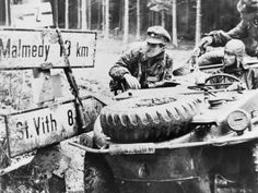 Men from 1st SS Panzer Division in a Schwimmwagen at Kaiserbaracke crossroads, between St. Vith and Malmedy, 18 December 1944.