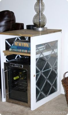 wine fridge table made out of salvaged leaded cabinet doors and 2x6, stained with minwax driftwood.