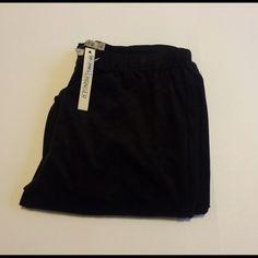 """Hanger velvet stretch leggings Hanger velvet stretch leggings Sz L  inseam 34"""" wide flare leg  90% polyester 10% spandex The hanger Pants Leggings"""