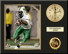 """One 8 x 10 inch Marshall University photo of Ahmad Bradshaw inserted in a gold slide-in frame and mounted on a 12 x 15 inch solid black finish plaque.  Also features a 3-inch Arabian gold-faced clock, a customizable nameplate* and a 2-inch """"ALL STAR"""" insert with a gold base.  $59.99 @ ArtandMore.com"""