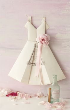 Diy Origami Book Page/Paper Dress (these would look so cute mounted inside a shadowbox) - Tutorial   ~ direct link to tutorial is here:  http://ideasmag.co.za/craft-decor/fold-an-origami-dress-menu/