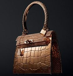 Wow! Now this is an impressive accessory!  Bag! Kelly bag, worth 1.9M The Kelly bag rose gold version was designed with 1,160 diamonds and crocodile style features by Pierre Hardy, but are there are only three units which makes them very limited