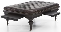 """The Bernhardt """"Brockton"""" coffee table ottoman features a button-tufted leather top, nailhead trim, and turned solid wood legs with vintage-style casters. Also includes a pair of pull-out shelves that add function to this eye-catching piece. I Weir's Furniture"""