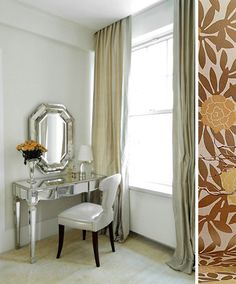 The Wall paper and the mirrored vanity, very nice.