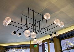 Local design company .PSLAB shows off their new lighting system for the Diptyque boutique in Paris.