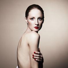 Fashion portrait of nude elegant woman. Studio photo
