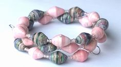 unique #bracelets #handmade from paper beads each individual bead is made from strips of paper, rolled and hardened and glazed. the colours are so vibrant and beautiful www.mimipinto.com
