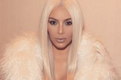 Nude Kim Kardashian Claims She Paid Kanye West's Debt, Goes for Bette Midler and Chloe Grace Moretz on Twitter