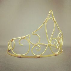 Its back! In a new simplified style, this delicate gold wire tiara is sure to complete your Sleeping Beauty costume! Made with super lightweight
