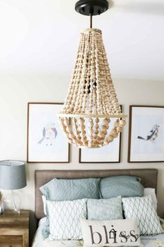 I love this DIY chandelier made from wood beads. It looks like it may take a while but it doesn't look hard! I love this DIY chandelier made from wood beads. It looks like it may take a while but it doesn't look hard!