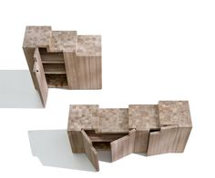 The elements designed to contain can become, even in their simplicity, part of a poetic vision.Monolithic two/three-door container made in italian walnut, with vertical fiber, surfaces carved with a hand plane and gouge, hidden bolts and hinges.The elements designed to contain can become, even in their simplicity, part of a poetic vision.