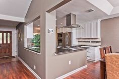 Now That's a Spicy Kitchen Load bearing wall? Leave a column and a header for support Kitchen Remodel, Kitchen Remodel Small, Kitchen Redo, Home Kitchens, Kitchen Layout, Kitchen Style, Modern Farmhouse Kitchens, Kitchen Renovation, Kitchen Design