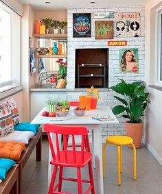 Dining Room decor ideas - bright and colorful, eclectic style dining room with a bright reds, blues, turquoise, yellow and greens.  Small dining table,  eclectic pop art gallery wall and built in wet bar.  Kitsch Design Trend's to add to your home! John Carne.