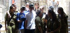 #PrincessCruises #travel - The serious side of Jerusalem gives way to some tomfoolery as female soldiers give my son Trevor (right) and his friend Glenn a good natured razzing. Military service is mandatory for all Israeli citizens.