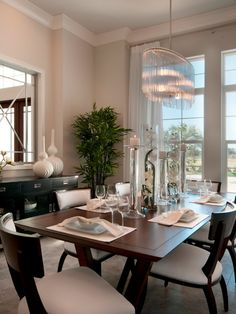The Dining area of The Isabella @The Founders Club in Sarasota, Florida. Built by London Bay Homes with interior design by Romanza.