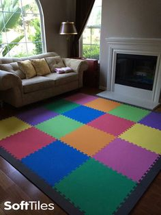 Living room play mat that uses SoftTiles 2x2 Interlocking Foam Mats. Create beautiful pattern and designs using our 12 different colors. #playroom #kidsdecor