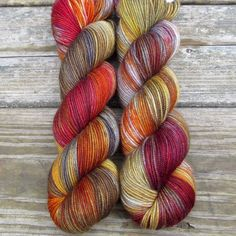 Shades of grey with red and yellow bring to mind armor, smoke, and flickering flames. While we call this a 'Repeatable Babette', every skein and every batch is a bit different. This colorway is also h