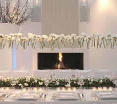 A gorgeous setting and suspended floral centerpiece...