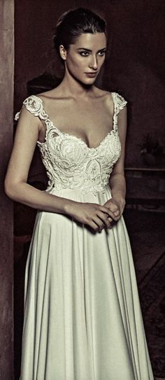 Classic empire wait wedding dress with embellished bodice; Featured Dress: Julia Kontogruni