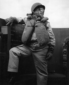 Captain Dixie Kiefer in battle dress on the command bridge of USS Ticonderoga during the launching of aircraft against Luzon, Philippines, Nov 6, 1944.