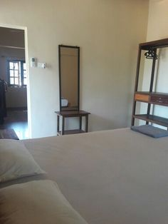 Morjim Sunset Guesthouse room with Ac and kitchen facility