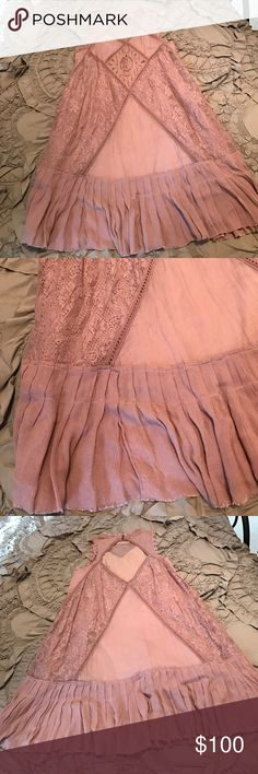 Free people ruffle dress Baby doll style with ruffle bottom, Maeve color with different materials of lace and sheer patches, open back detail with high neck style in front and button closure at back of neckline, sleeveless and chic style, worn twice Free People Dresses