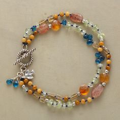 """ROPE OF MANY COLORS BRACELET--Stones of many kinds and colors—labradorite, moonstone, topaz, peridot, coral, citrine, neon apatite, yellow jasper, carnelian among them—shimmer and shine up and down double-stranded ropes. Toggle closure. Exclusive. 7-1/2""""L."""